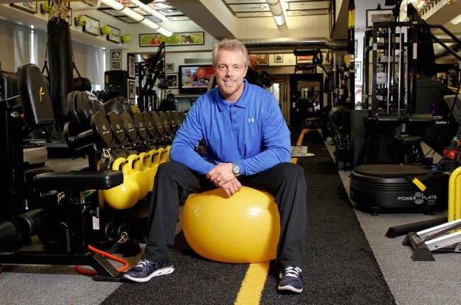 Gunnar Peterson sitting on an exercise ball
