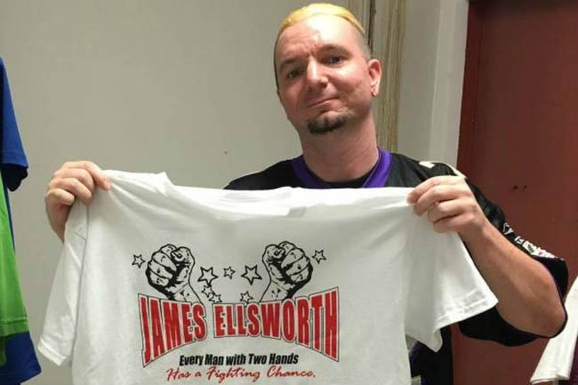 James Ellsworth shows off his WWE merchandise t-shirt