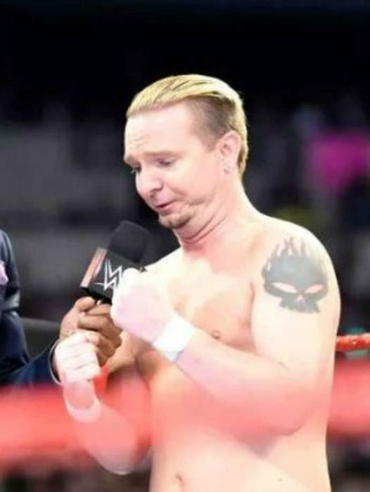 James Ellsworth interacts on stage in an episode of Raw in 2016