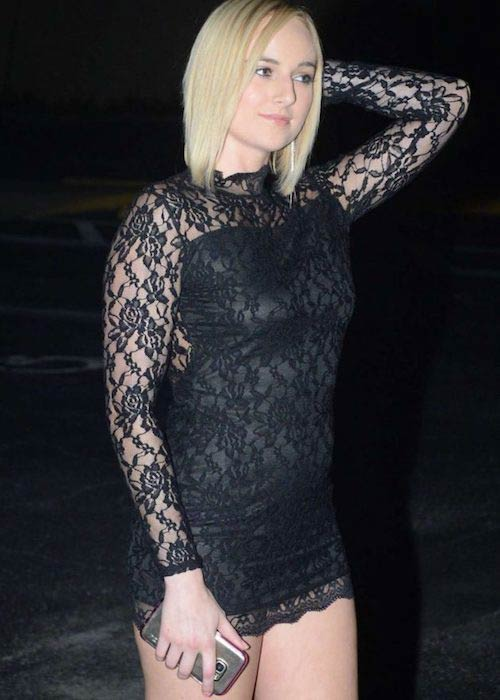 Kate England in black mini dress in August 2016
