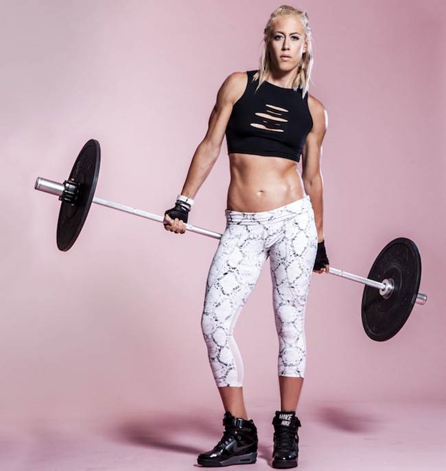 Lacey Stone holding a barbell