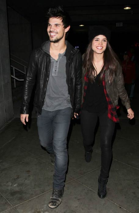 Marie Avgeropoulos and Taylor Lautner at the Jay-Z concert in Los Angeles in December 2013