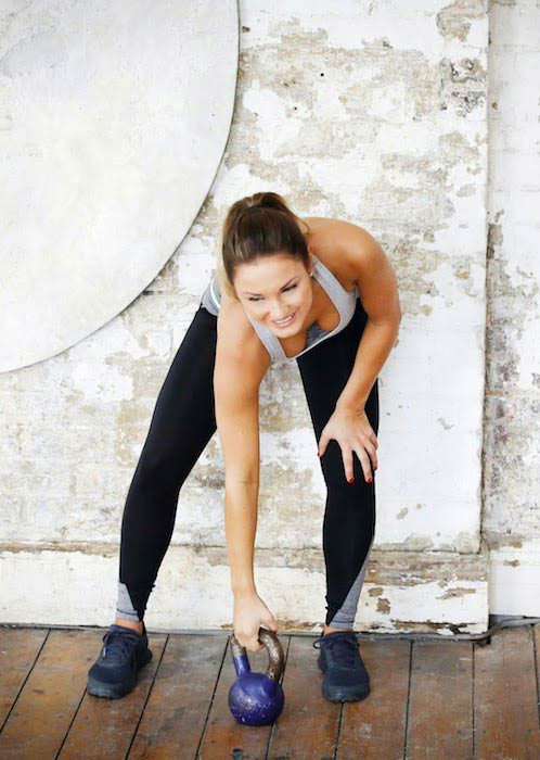 Sam Faiers working out with a kettlebell