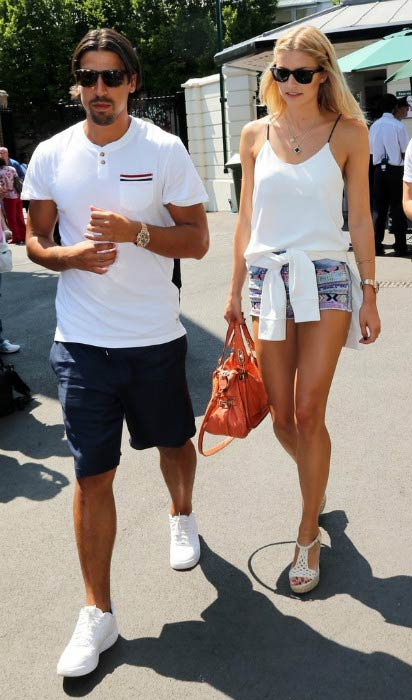Sami Khedira and Lena Gercke at the Men's Final during Wimbledon Tennis Championships in London in July 2013