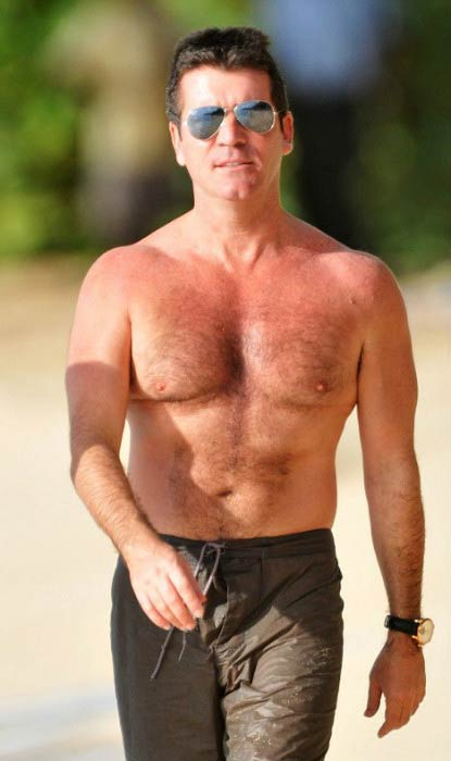 Simon Cowell shirtless body at a Barbados Beach in December 2008