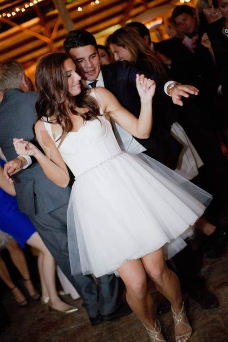 Alex Morgan and Servando Carrasco celebrate at their wedding reception on December 31, 2014