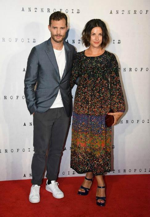 "Amelia Warner and her husband Jamie Dornan at the ""Anthropoid"" UK film premiere in August 2016"