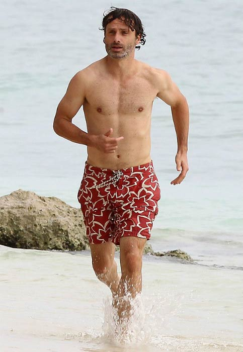 Andrew Lincoln shirtless on the Caribbean beach in August 2013