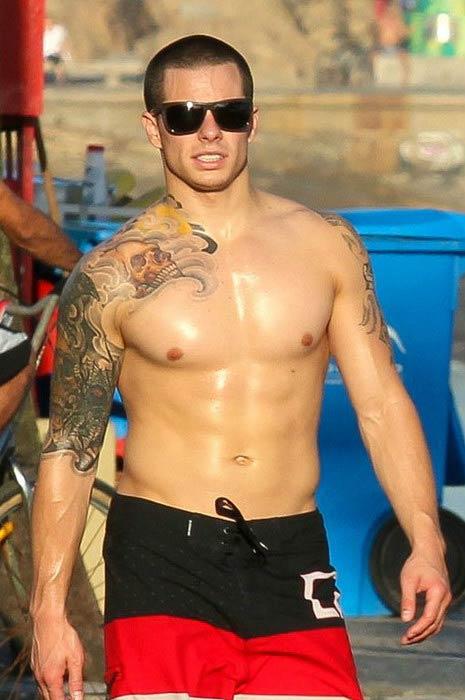 Casper Smart shirtless at a beach in Recife, Brazil in July 2012