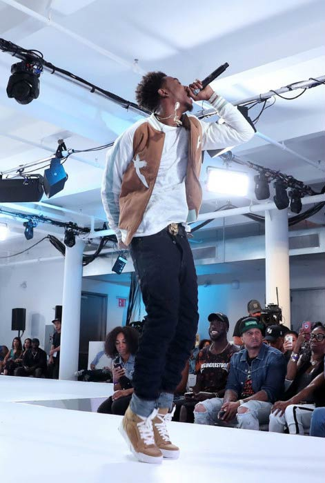 Desiigner performing onstage during the BET How To Rock: Denim show in August 2016