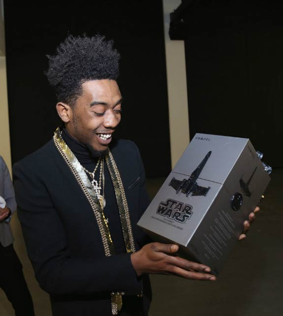Desiigner with Propel Star Wars Battle Drones at Def Jam's Holiday Party in December 2016