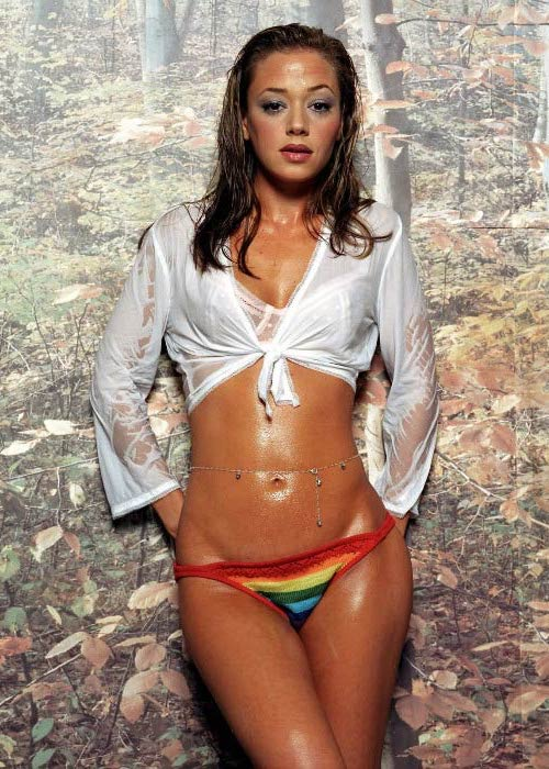 Leah Remini in Nightlife magazine in a white top and rainbow pattern bottom
