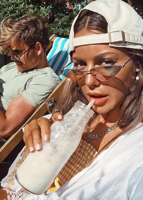 Louise Thompson drinking peanut butter milkshake at Antipodea Putney in June 2018