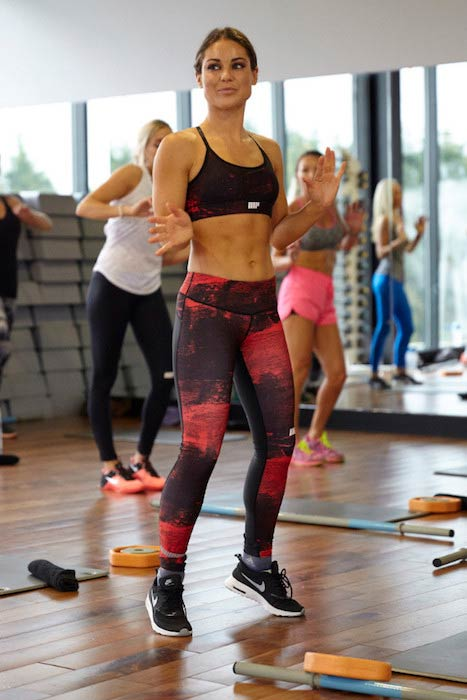 Louise Thompson exercising in a fitness class