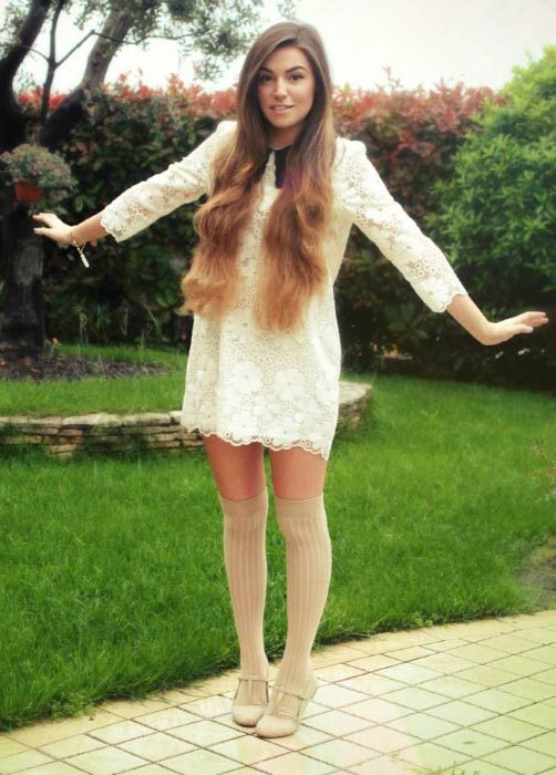 Marzia Bisognin showing her white dress in a social media picture