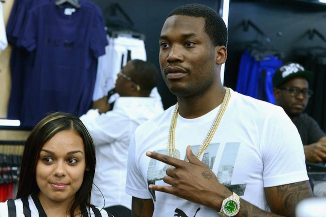 Meek Mill (Right) with a guest at the Meek Mill Debut of Dreamchasers x PUMA Collab at New Puma Lab in July 2016