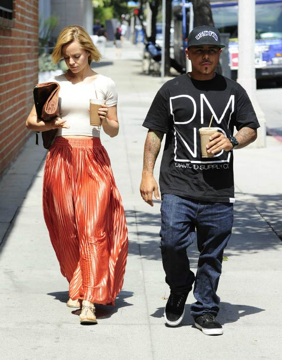 Mena Suvari and Salvador Sanchez leaving Planet Raw restaurant in August 2012