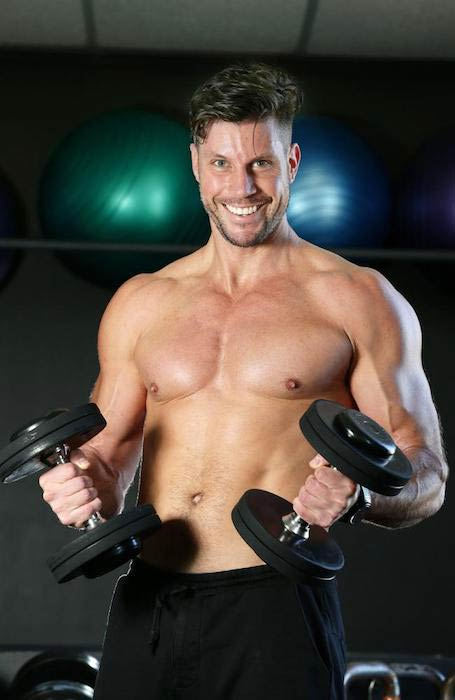 Sam Wood doing dumbbell bicep curl