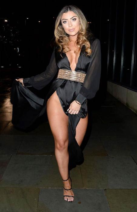 Abigail Clarke flashes her cleavage and legs in a dress as she goes out for Danny Simpson's birthday party on January 9, 2017