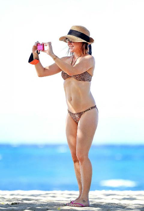 Alyson Hannigan in bikini on the Hawaii beach in December 2014