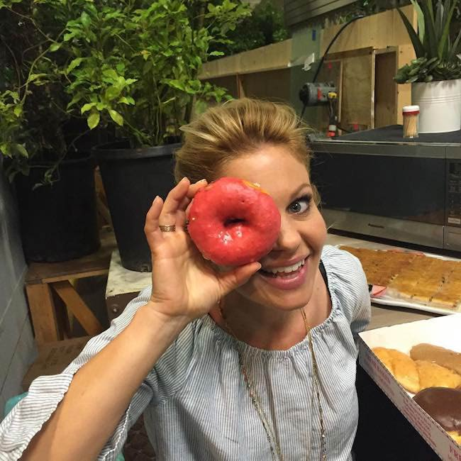 Candace Cameron-Bure showing a donut