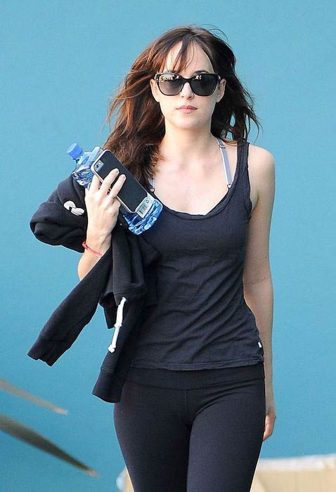 Dakota Johnson after workout heading towards parking lot