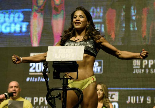 Julianna Pena weighing on the scale during her weigh-in for UFC 200 in July 2016