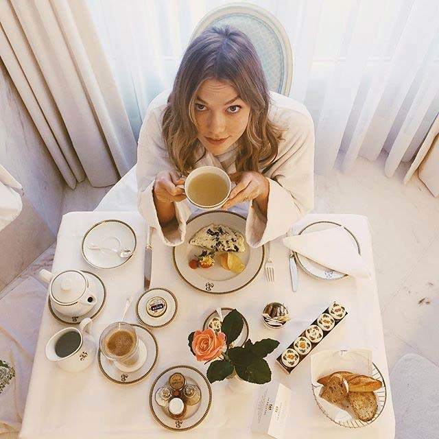 Karlie Kloss having her meal