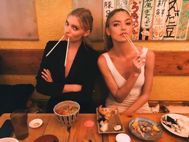 Martha Hunt (Right) having food in a restaurant