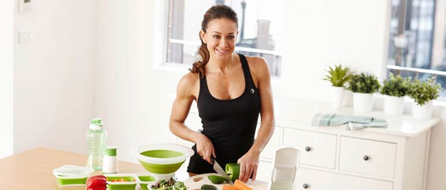 Michelle Bridges preparing food in the kitchen