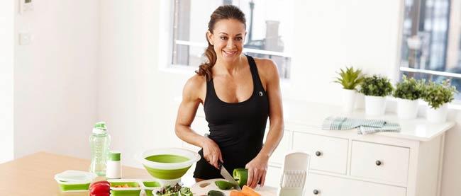 Michelle Bridges preparing food in the kitchen
