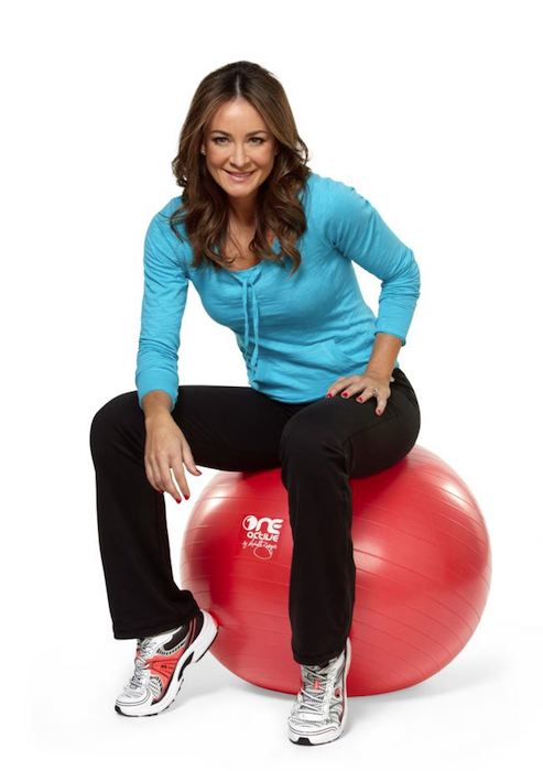Michelle Bridges sitting on the ball