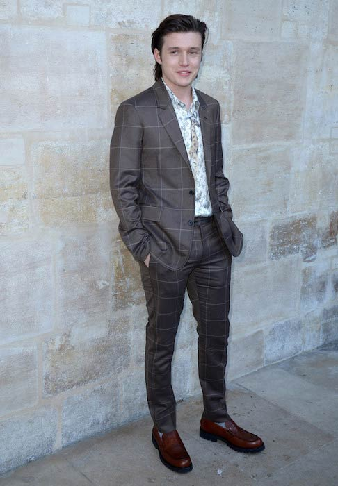 Nick Robinson at the Louis Vuitton Menswear Fall / Winter 2017-2018 show during Paris Fashion Week