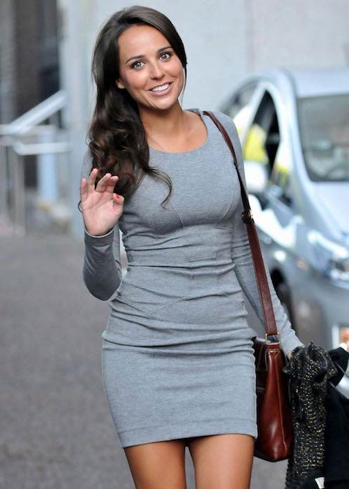 Polly Parsons looks lovely in a gray dress
