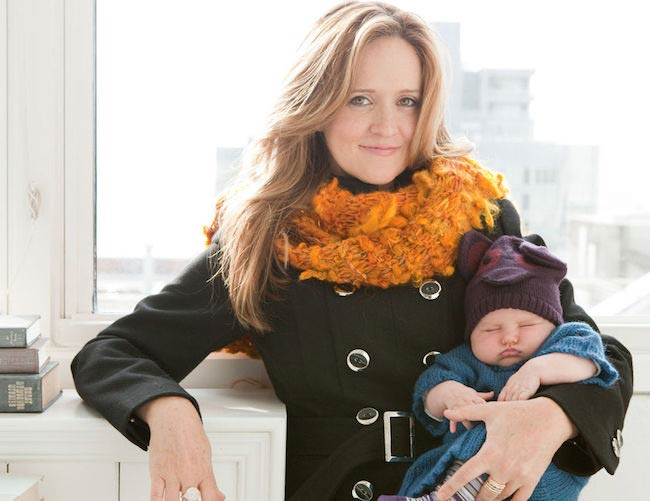 Samantha Bee holding her baby
