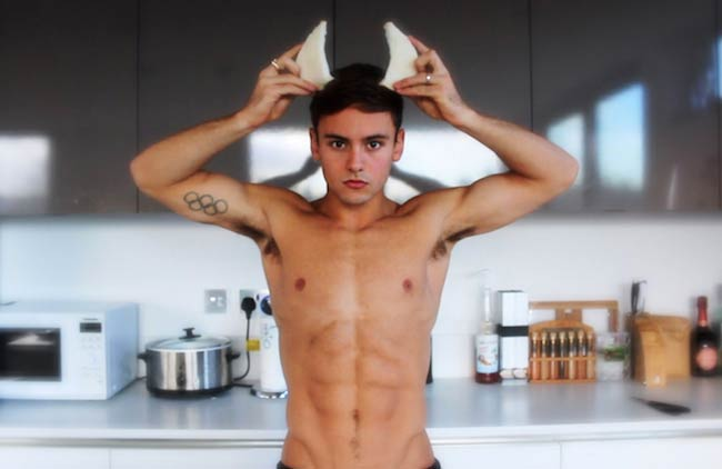 Tom Daley in the kitchen showing his abs