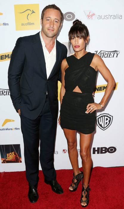 Alex O'Loughlin and surfer Malia Jones at the Australians in Film Benefit Dinner in October 2013