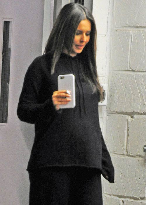 Cheryl Cole showing her baby bump in loose jumper