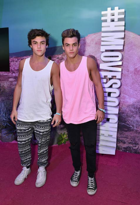 Ethan Dolan (white vest) with his brother Grayson Dolan at the H&M Loves Coachella Pop UP in April 2016