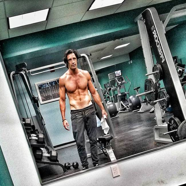 Gilles Marini showing his abs while in gym