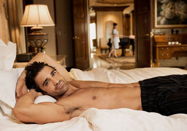 Gilles Marini shirtless lying on bed