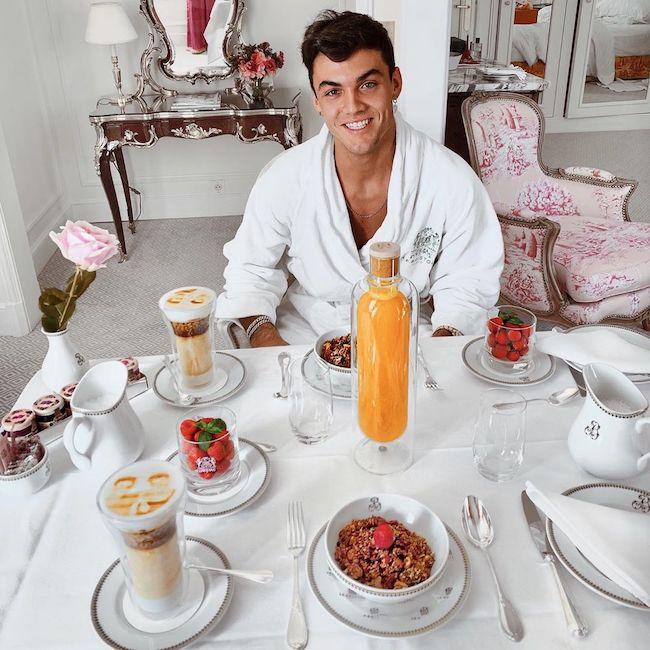 Grayson Dolan having a breakfast in hotel in Paris, France in 2019