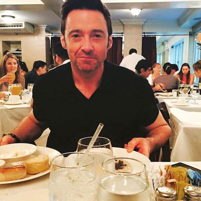 Hugh Jackman tasting good food as seen in June 2015
