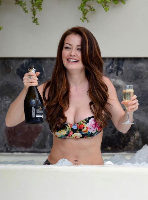Jess Impiazzi holding a drink