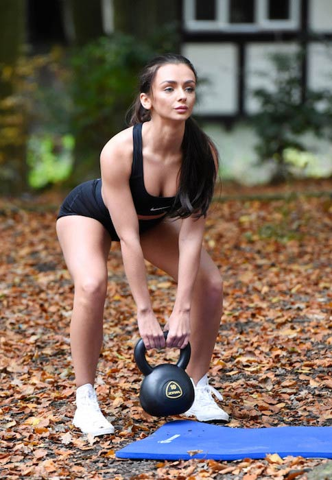 Kady McDermott exercising with a kettlebell