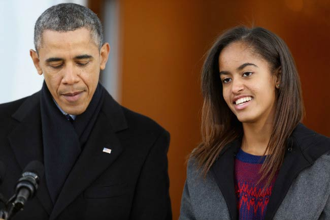 Malia Obama with father Barack Obama at the White House conference in November 2013