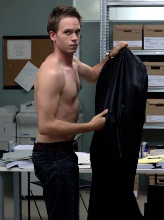 Patrick J. Adams shirtless in a scene from Suits