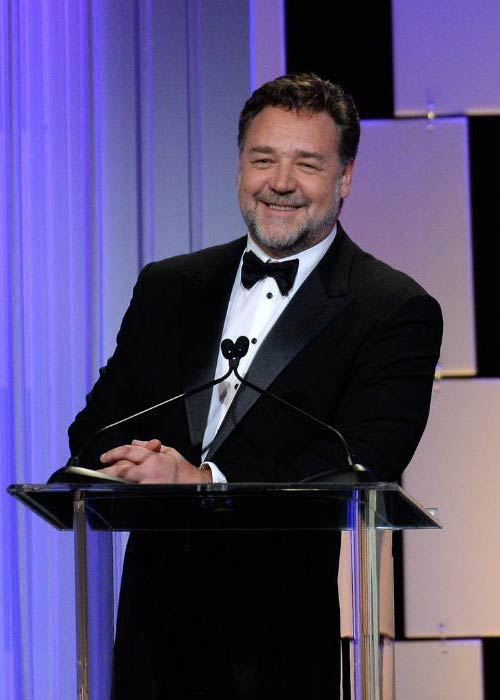 Russell Crowe speaking onstage at the 30th Annual American Cinematheque Awards Gala in October 2016 in California