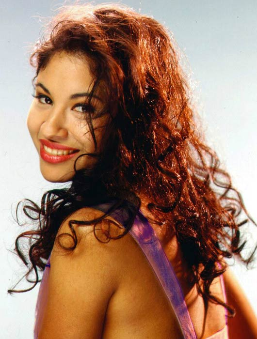 Selena Quintanilla posing for a portfolio photoshoot
