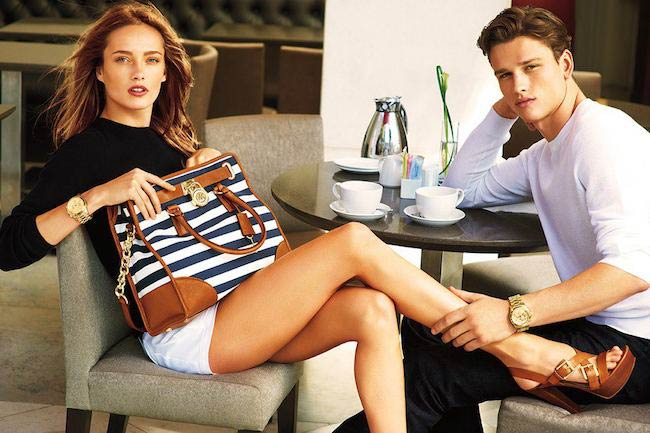 Simon Nessman with a female model advertising a watch